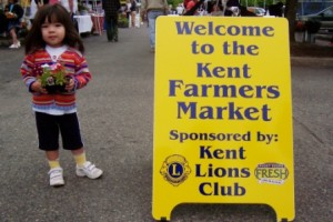 Little Girl with KFM Sign